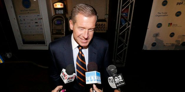 Television journalist Brian Williams arrives at the Asbury Park Convention Hall during red carpet arrivals prior to the New J