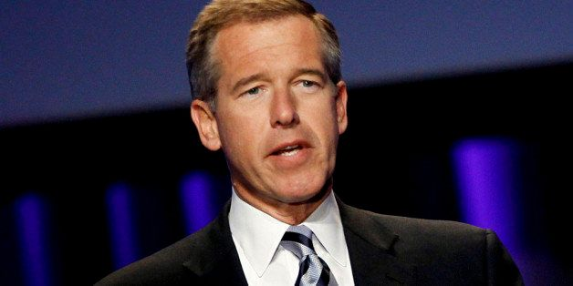 """FILE - In this Oct. 26, 2010 file photo, Brian Williams, anchor and managing editor of """"NBC Nightly News,"""" speaks at  the Wom"""