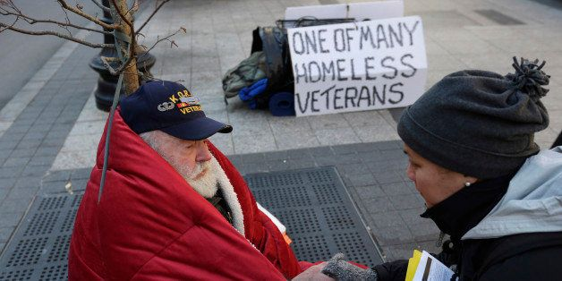 In this Wednesday, Nov. 20, 2013 photo, homeless Korean War veteran Thomas Moore, 79, left, speaks with Boston Health Care fo