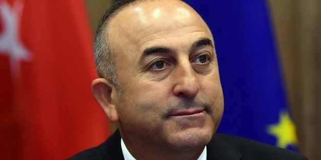 Turkey's Foreign Minister Mevlut Cavusoglu poses prior to take part in an EU-Turkey association council at the European Counc