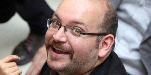 FILE - In this photo April 11, 2013 file photo, Jason Rezaian, an Iranian-American correspondent for The Washington Post, smi