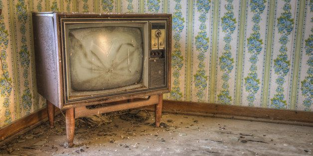 Abandoned TV in a derelict house.