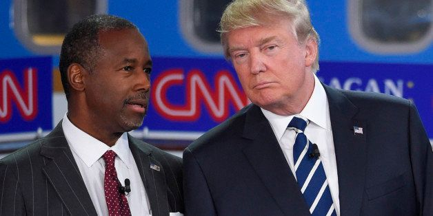 Republican presidential candidates Ben Carson, left, and Donald Trump talk before the start of the CNN Republican presidentia