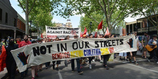 BENDIGO, AUSTRALIA - OCTOBER 10: Hundreds of demonstrators walk with banners during an anti-racism rally as anti-mosque prote