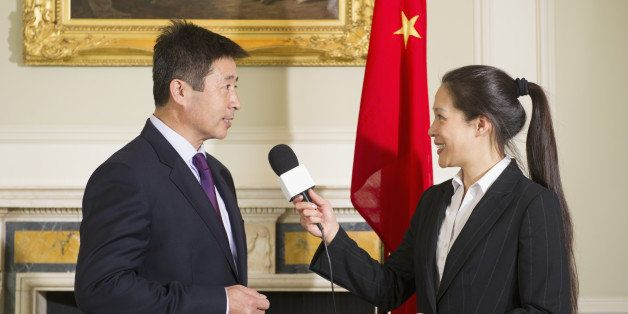 Chinese businessman giving interview