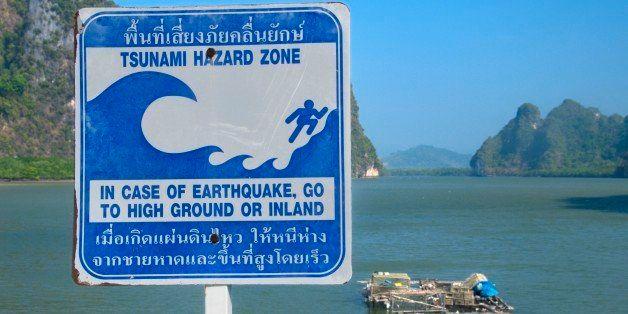 Thailand, Phang-Nga Bay, Ko Panyi, tsunami hazard zone sign in front of bay