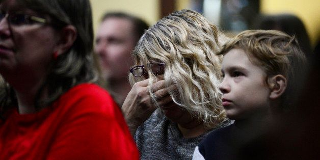 COLORADO SPRINGS, CO - NOVEMBER 29: Tracy Gilliland cries while they talk about Officer Garrett Swasey at Hope Chapel on Nove