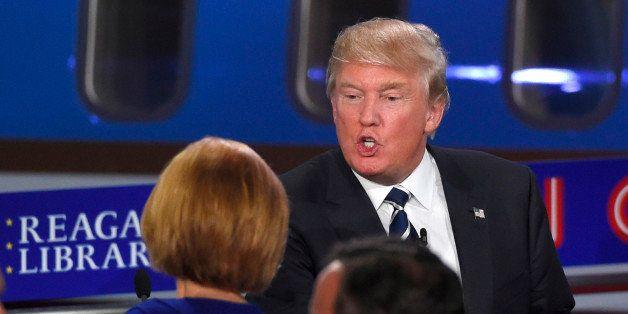 Republican presidential candidate, businessman Donald Trump, top, talks with Carly Fiorina following the CNN Republican presi