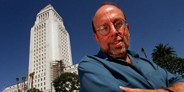 With City Hall behind him, Harold Meyerson poses for a potrait, Monday afternoon in downtown Los Angeles. After several years