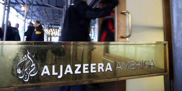 NEW YORK, NY - JANUARY 13:  People walk into the offices of Al Jazeera America, a cable news channel that debuted in August 2