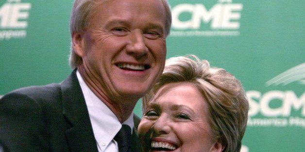 UNITED STATES - JUNE 19:  Panel moderator Chris Matthews of MSNBC, left, hugs Senator Hillary Rodham Clinton after she spoke