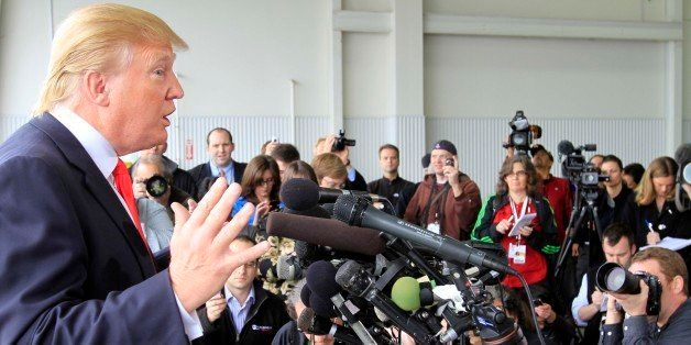 Donald Trump, a possible 2012 presidential candidate, talks to reporters after arriving at the Pease International Tradeport
