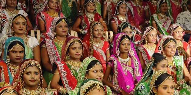 This photo taken on December 6, 2015 shows brides at a mass-marriage ceremony for 151 fatherless women, in Surat, around 265