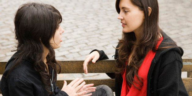 Teenage girl and woman talking