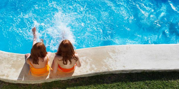 Girls Sitting Poolside