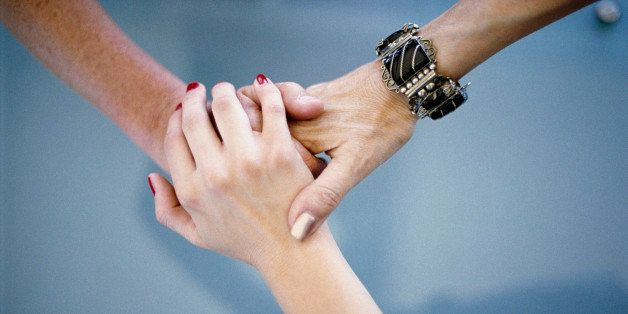 Close-up of women holding hands