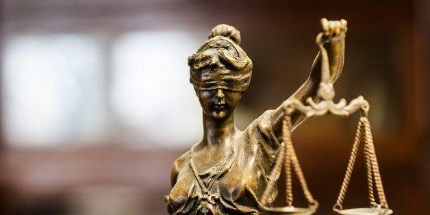 Bronze statuette of justice (focus on face)