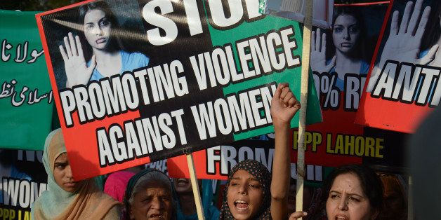LAHORE, PUNJAB, PAKISTAN - 2016/06/03: Women activists of Pakistan Peoples Party (PPP) hold placards and chant slogans for vi