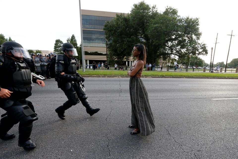 Protestor Ieshia Evans is approached by law enforcement near the headquarters of the Baton Rouge Police Department in Baton R