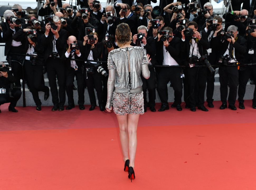 Kristen Stewart faced by a wall of male photographers at Cannes