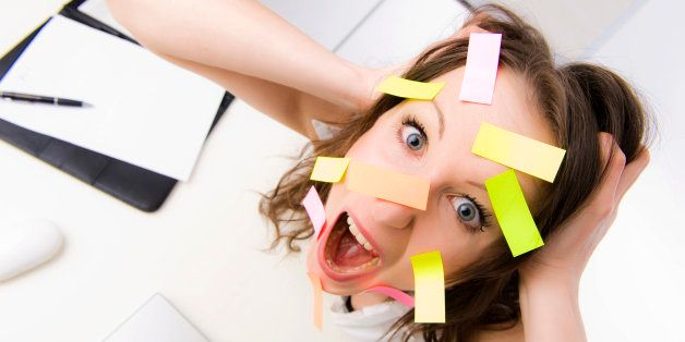 Overwhelmed office worker with many post-its on her face