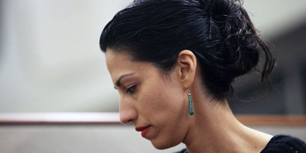 NEW YORK, NY - JULY 23:  Huma Abedin, wife of Anthony Weiner, a leading candidate for New York City mayor, listens as her hus