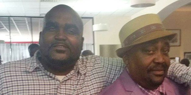 This undated photo provided by the Parks & Crump, LLC shows Terence Crutcher, left, with his father, Joey Crutcher. Crutc