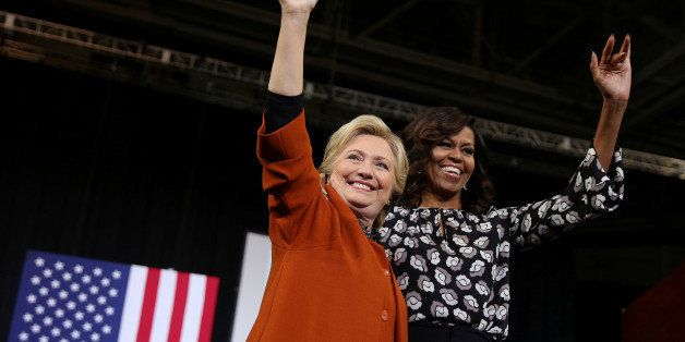 U.S. Democratic presidential candidate Hillary Clinton arrives to a campaign rally accompanied by U.S. first lady Michelle Ob