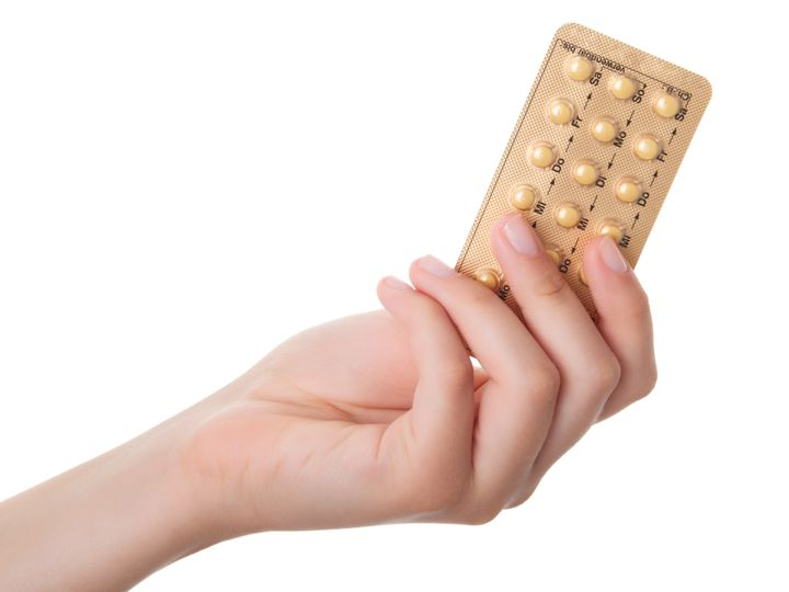 tablets (Birth Control Pills) in the hand, isolated on white background