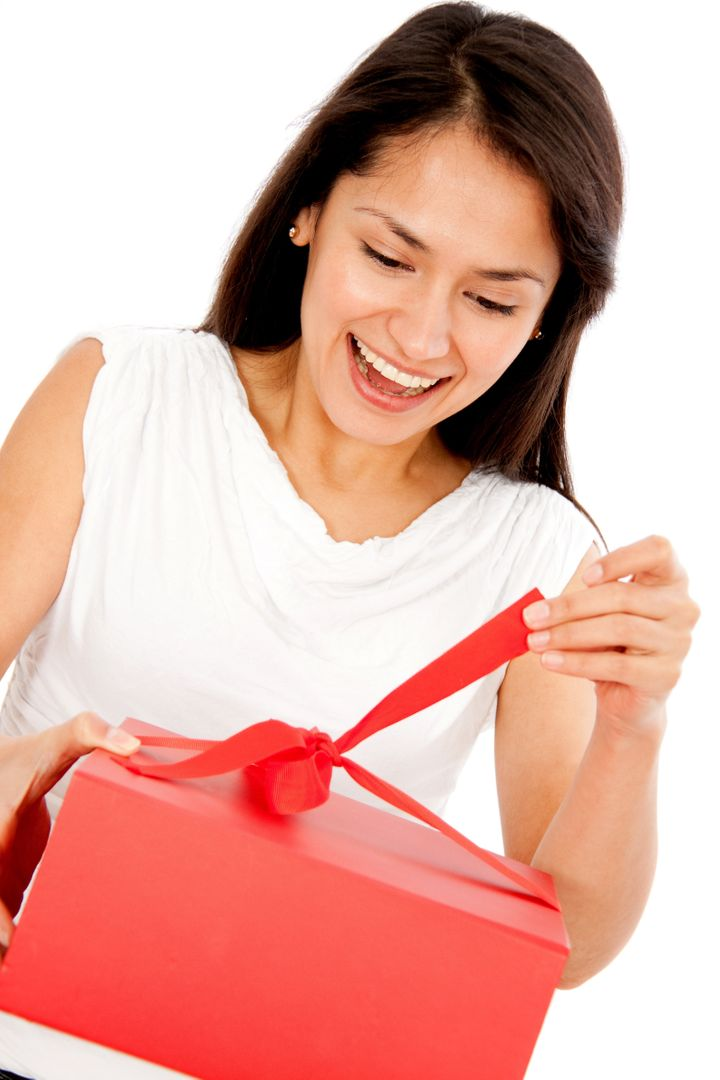 Happy woman opening a present - isolated over white