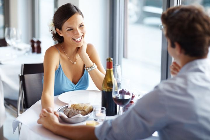 An attractive young woman on romantic date with her sweetheart in a restaurant
