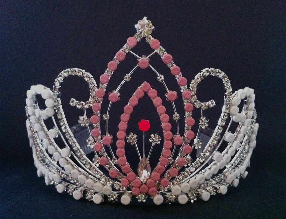 """(Note the red birth control """"G-spot"""" in the center of the tiara.)"""