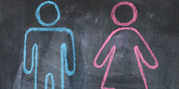 Figures of man and woman on a blackboard, chalk