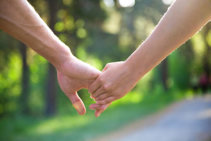 two pairs of hands in love...
