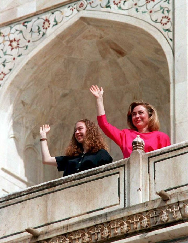 AGRA, INDIA - MARCH 30:  US First Lady Hillary Clinton (R) and her daughter Chelsea wave from the terrace of  the Taj Mahal i