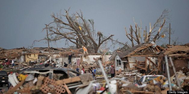 MOORE, OK - MAY 20:  People assess the damage after a powerful tornado ripped through the area on May 20, 2013 in Moore, Okla