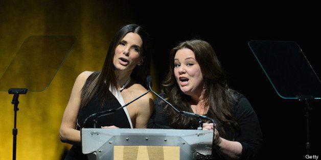 LAS VEGAS, NV - APRIL 18:  Actresses Sandra Bullock (L) and Melissa McCarthy speak during a Twentieth Century Fox presentatio