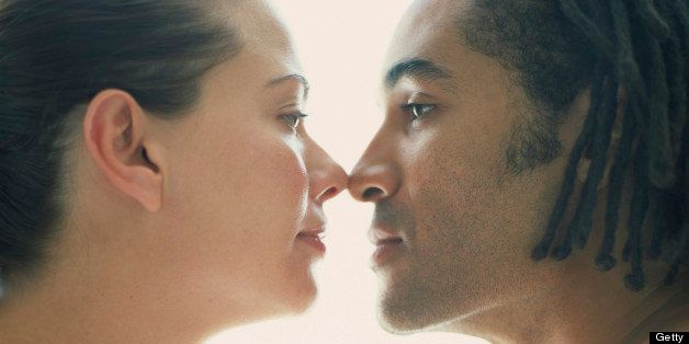 Couple touching nose, side view
