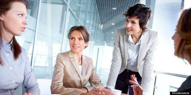female business team of four...