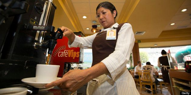 Waitress Clara Beltran pours coffee at a Vips restaurant in the El Toreo neighborhood of Mexico City, Mexico, on Monday, June