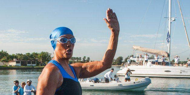 US swimmer Diana Nyad waves before attempting to swim in a three-day non-stop journey from Havana to Florida at the Ernest He