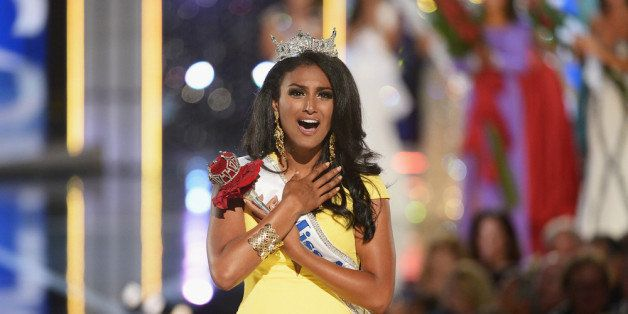 ATLANTIC CITY, NJ - SEPTEMBER 15:  Miss America 2014 contestant Miss New York Nina Davuluri wins the 2014 Miss America Compet