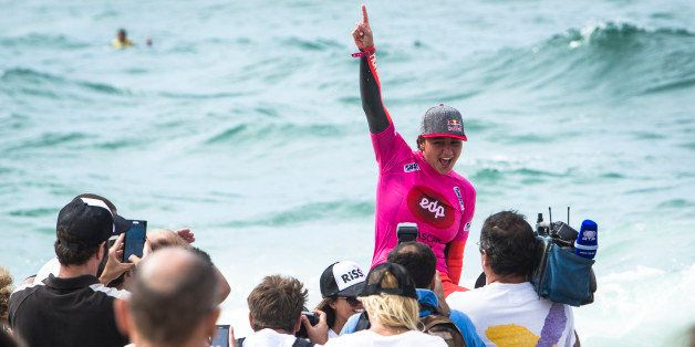 CASCAIS, PORTUGAL - OCTOBER 5: Carissa Moore from Hawaii celebrates taking the win and the world title at EDP Girls Pro on Oc