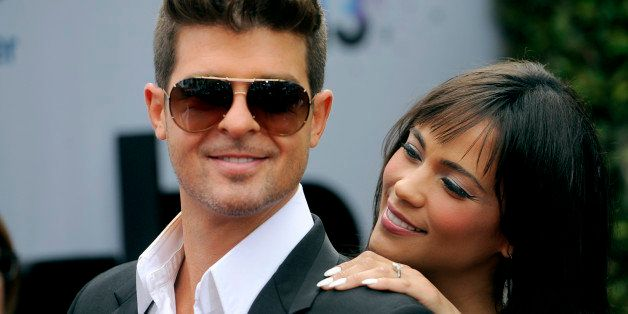 Robin Thicke and his wife Paula Patton arrive at the BET Awards at the Nokia Theatre on Sunday, June 30, 2013, in Los Angeles