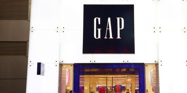 A man walks past a Gap Inc. store in the Wangfujing shopping district of Beijing, China, on Sunday, March 10, 2013. China?s i