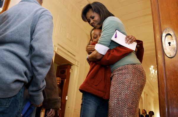 This little girl might be the luckiest kid in the world after receiving a bear hug from Michelle in 2009 at a White House eve