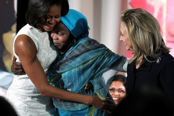 Hawa Abdallah Mohammed has the right idea here as she snuggles into Michelle's welcoming arms and seems to never want to leav