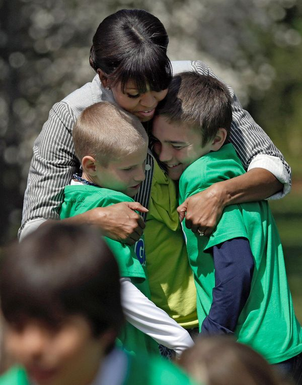 She always seems to fit multiple children in her incredibly hug-ready arms. Here Michelle embraces two students after plantin