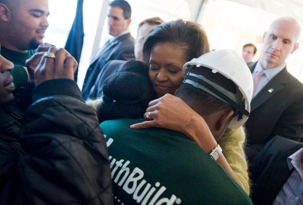 Michelle Obama must have the Mary Poppins bag of arms -- an endless wingspan that manages to hug everyone at once.