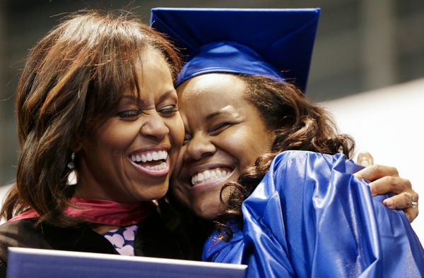 Anyone else super jealous that they didn't get a hug from the first lady on their college graduation day? We are.